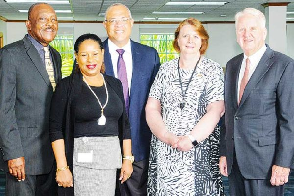 Image: Outgoing Chief Executive Officer; Gary Brown (right) Colette Delaney, CEO Designate and new Chair of the FirstCaribbeanComTrust Foundation (second right); Mark St. Hill, Trustee and Managing Director, Retail and Business Banking, Debra King, Trustee and Director of Corporate Communications; Clenell Goodman, Trustee. Missing are: Lynda Goodridge, Trustee and overseas-based Trustees Trevor L. Torzsas and Ladesa James-Williams.