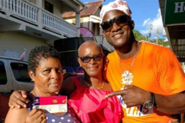 Image of Darren Sammy pointing to tickets he wants Saint Lucians to buy, to support defending champions at home,