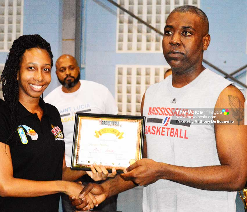 Image of Shervon Matthew (RSLPF) receiving his award from a representative of SLBF (Photo: Anthony De Beauville)