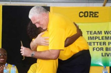 Image of PM Allen Chastanet and a member of the UWP embracing at the party convention