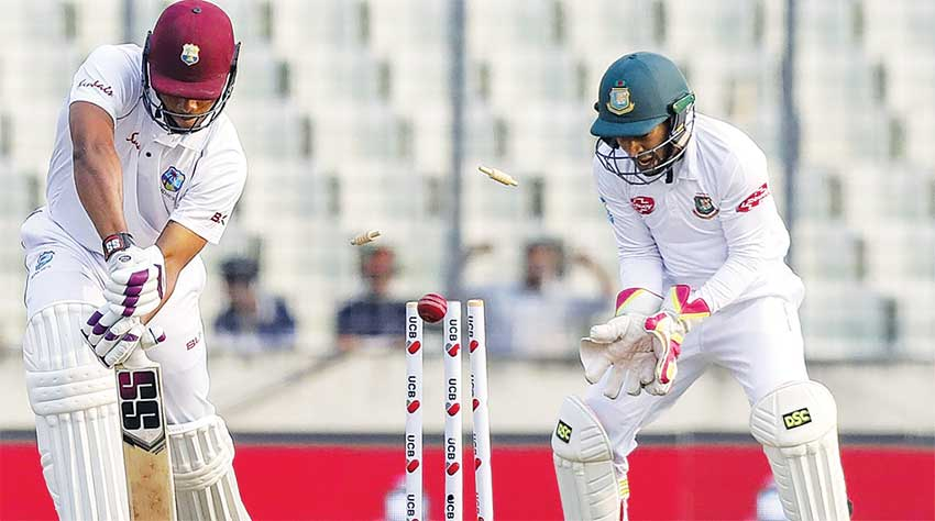Image: West Indies batsman Kieran Powell loses his off stump. (PHOTO: AFP)