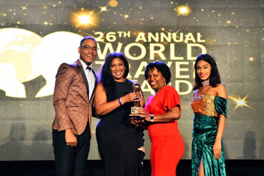 Image: Accepting award for 'Caribbean's Leading Honeymoon Destination'