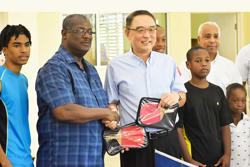 Image: Hon. Stephenson King receiving sporting equipment donation from the Taiwanese Embassy