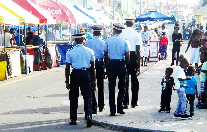 Image: Police officers kept the beat and the peace in Vieux Fort for the holidays, much to the appreciation of citizens. (PHOTO: Kingsley Emmanuel)