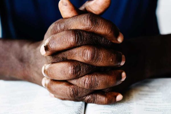 Image of hands clasped in prayer