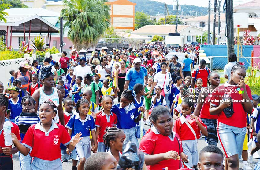 Image: Students walking under the theme 'Healthy Bodies for Energetic Minds'. (PHOTO: Anthony De Beauville)