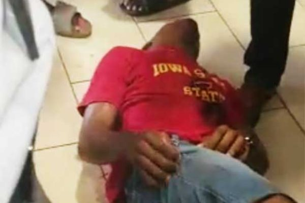 Image of victim on the floor of the mall