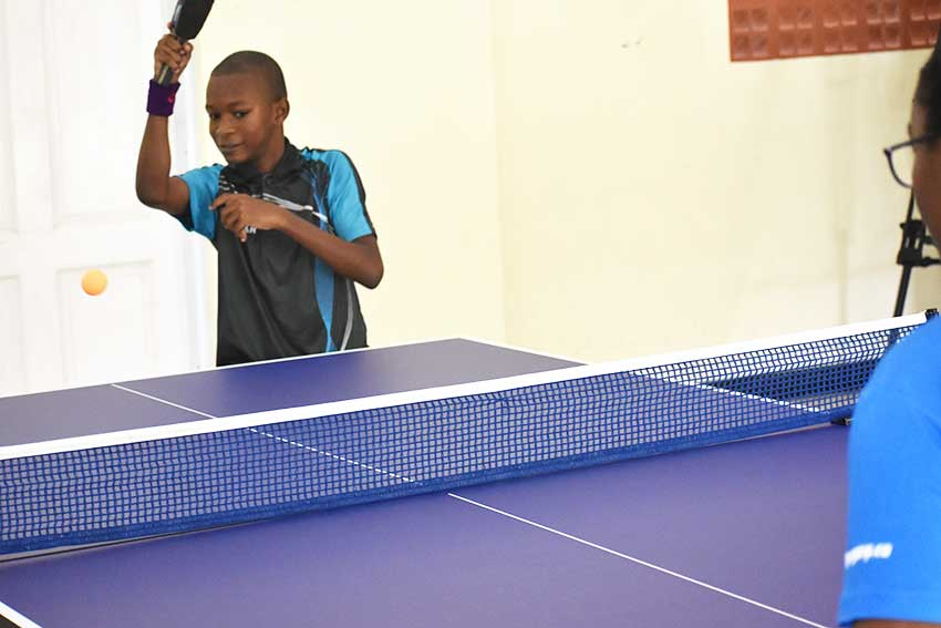 Image: Youth in community enjoying a game of table tennis equipment