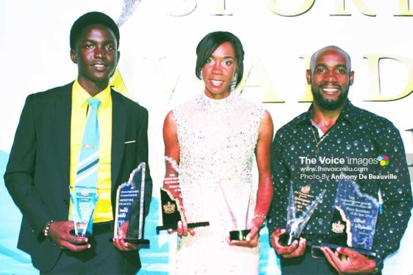 Image: (L-R) A proud moment for the Babonneau connection, Kimani Melius (Junior Sportsman for the Year), Levern Spencer and Albert Reynolds (Senior Sportswoman and Sportsman for the Year). (PHOTO: Anthony De Beauville)