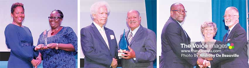 Image: (L-R) Tessa Louis (President Lightning Aquatic Swim Club) receiving the award for Club of the Year from Mary Wilfred; Governor General, Sir Neville Cenac presenting the Lifetime Award to Hollis Bristol and Sports Minister, Edmund Estaphane presenting Jane and Dunstan Du Boulay with the Minister's Award. (PHOTO: Anthony De Beauville)