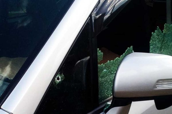 Image of bullet riddled car