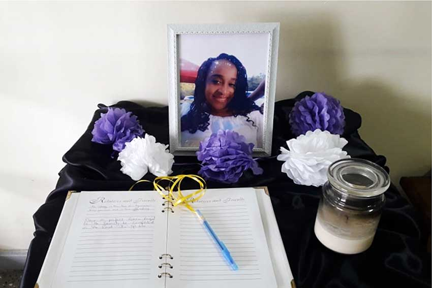 Image of A memorial which was set up at the Office of the Commissioner of Police in memory of Tamara Charles Laure.