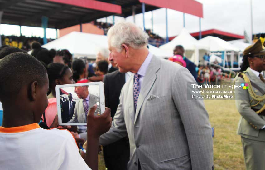 Image: A spectator gets up close and personal to royalty. (PHOTO: PhotoMike]