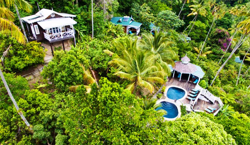 Aerial view of cottage and pools at Fond Doux Plantation & Resort.