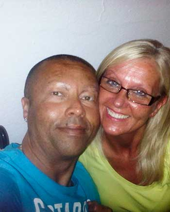 Image of Damon Gilbert with partner Sandra Leah Mitchelson. The UK resident is searching for his family in Saint Lucia.