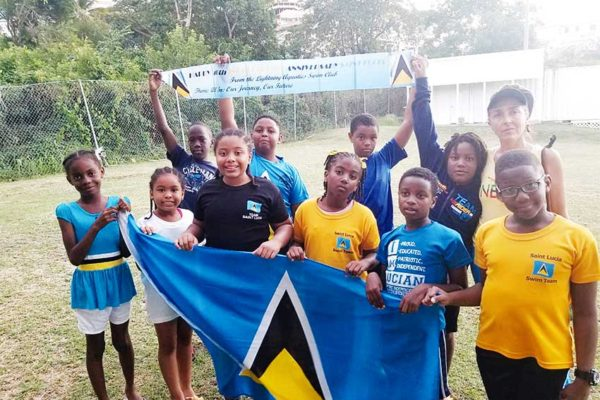 Image of L.A. junior swimmers with Coach Stefania celebrating Independence.