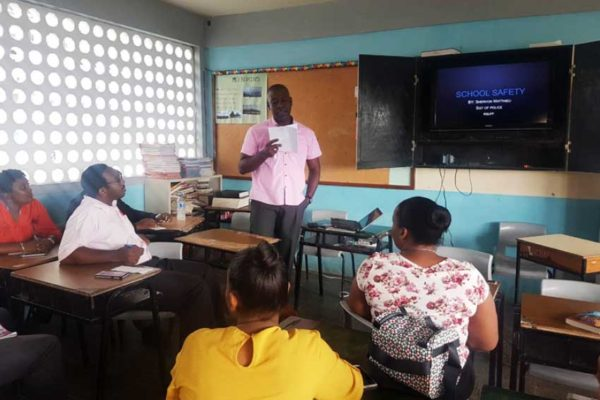 Image of Sergeant Matthieu addressing staff of the Babonneau Secondary School