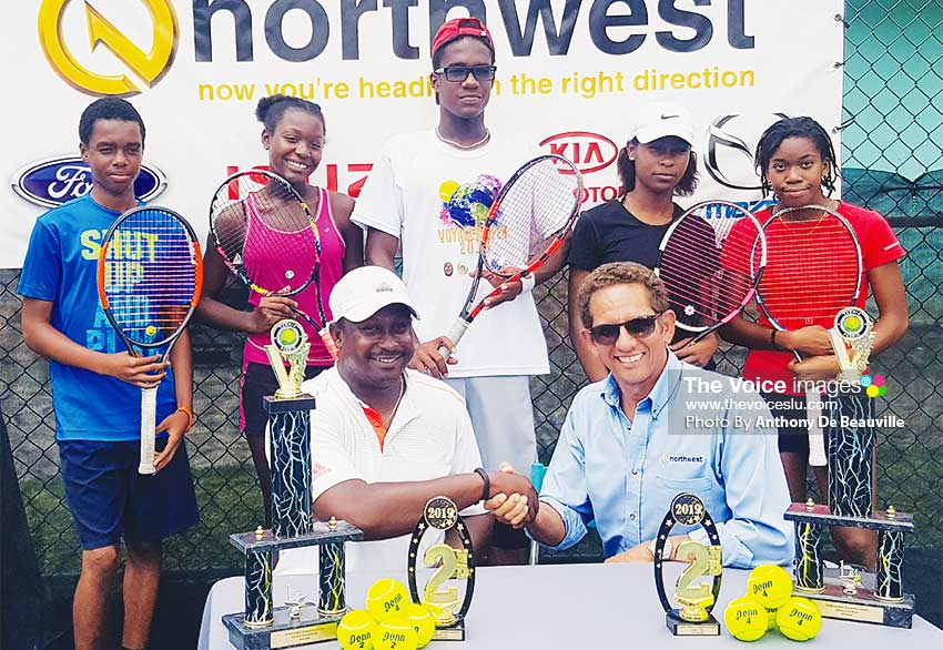 Image: (Back row) Some of the players taking part in the tournament; (front row – L-R)SirseanArlain and Larry Bain, the hand shake signifies a long haul between Tiger Tennis Academy and Northwest Limited. (PHOTO: Anthony De Beauville)