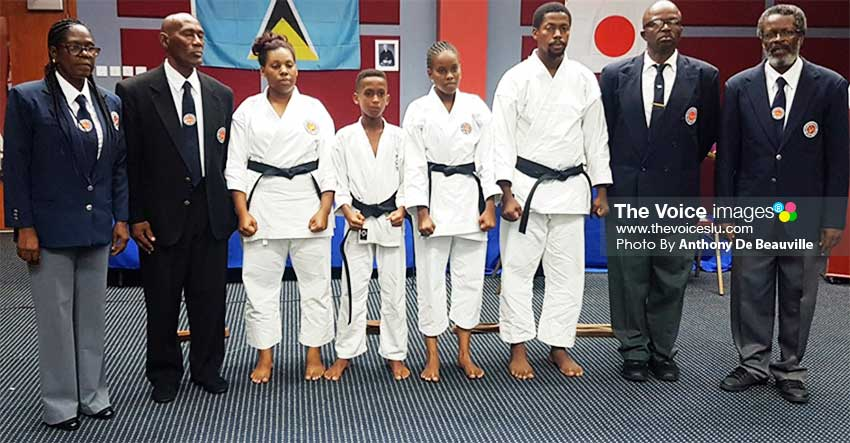 Image: (L-R) A photo moment for Sensei Deborah Jn Baptiste 4th Dan SKIF, Sensei Victor Dudley 5th Dan SKIF, (Black Belts) Twinki Stephen, Malik Peter, Analee Stephen, Claudius Athill; Sensei Oliver Lawrence 6th Dan SKIF and Sensei Ezra Jn. Baptiste 6th Dan SKIF, Chief Examiner . (PHOTO: Anthony De Beauville)