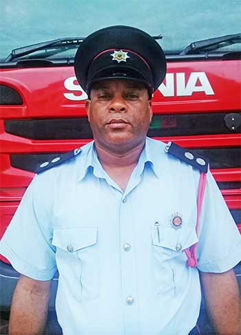 Image of Alyn Roserie, Officer in Charge of the Dennery Fire Station.
