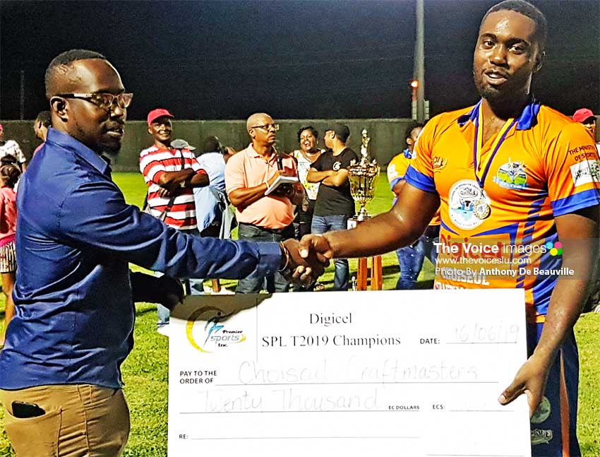 Image: A member of the SPL T20 Team Kirby Sydney presenting CCM captain Bronte Bess with a cheque worth EC$20,000.00. (PHOTO: Anthony De Beauville)