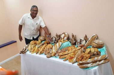 Image of Minister Felix showing off the Caribbean Grains