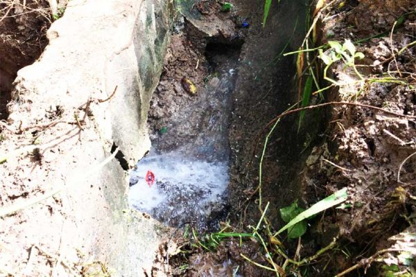 Image: Ruptured WASCO pipe inside drain in Independence City.