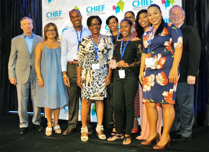 Image of Bay Gardens team members and CHTA officials at the CHIEF Awards ceremony.