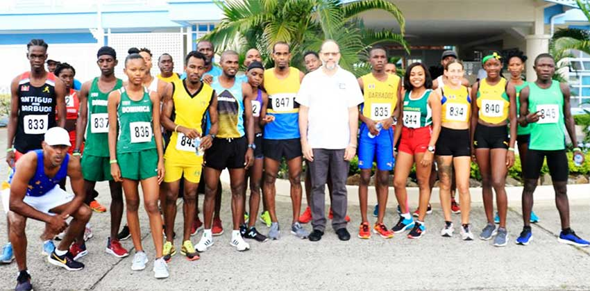 A photo moment for Caricom Secretary-General Ambassador Irwin LaRocque and race participants on Sunday. (PHOTO: NM)
