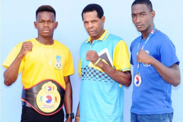 Image: (L-R) Kareem Boyce 60 kg champion, Conrad Frederick - National Boxing Coach and silver medalist Nathan Ferrari. (PHOTO: DP).