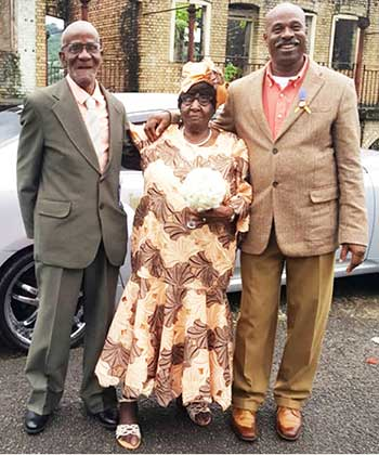 Image of Mr & Mrs Paul with their son Vitalis Louis (right).