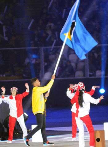 Image of Saint Lucia's Flag Bearer Luc Chevrier. (PHOTO: David Pascal)