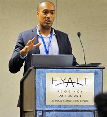 Image of Sanovnik Destang, Executive Director of Bay Gardens Resorts, addressing delegates at the Caribbean Hospitality Industry Exchange Forum (CHIEF) in Miami last month.