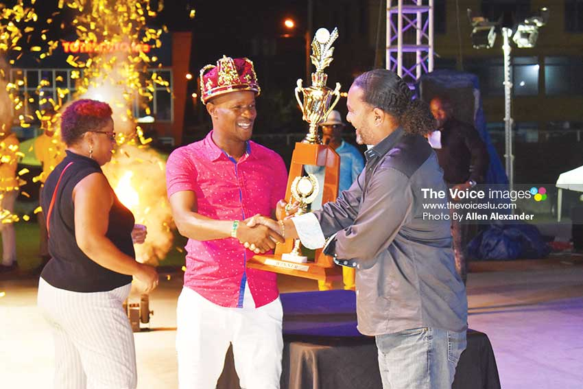 Image of Ti Carro receiving his award from CDF Chairman, Daniel Belizaire. [PHOTO BY Allen Alexander]
