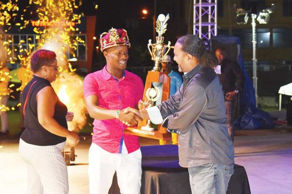 Image of Ti Carro receiving his award from CDF Chairman, Daniel Belizaire.