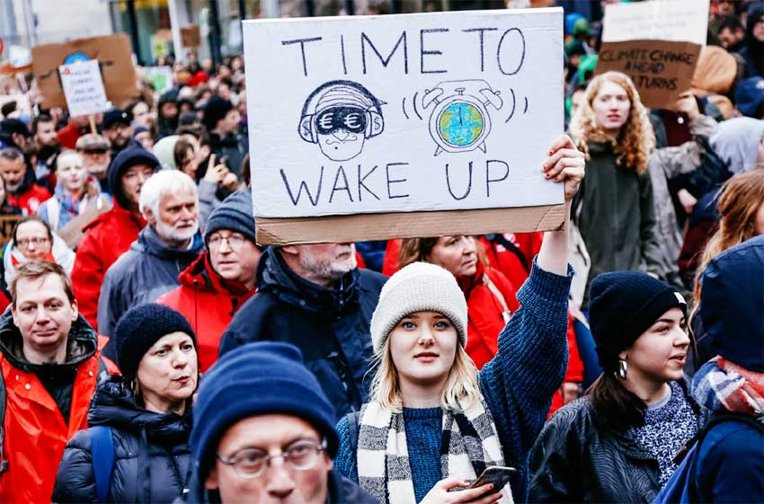 Image of a woman holding a placard takes part in a demonstration against climate change in Brussels, Belgium, March 15, 2019.