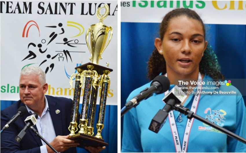 "Image: (L-R) Prime Minister Allen Chastanet says ""This is the trophy you should be proud about""; three year WISG volleyball player Matilda Angeloni. (Photo: Anthony De Beauville)"
