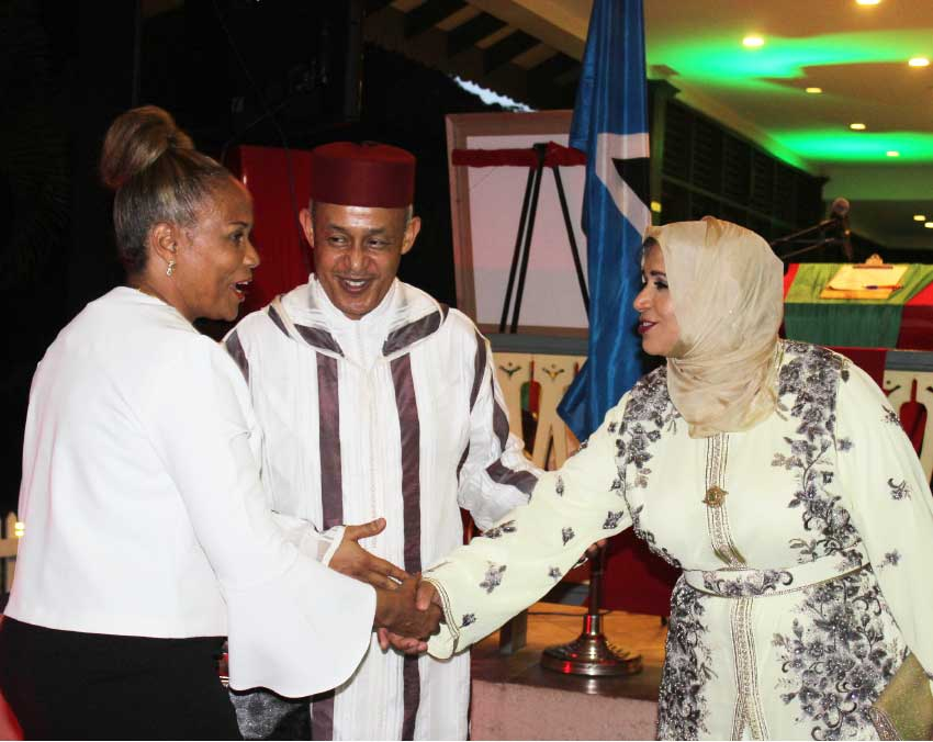 Image of Ambassador Kadmiri and wife greeting a guest at Tuesday's celebrations.