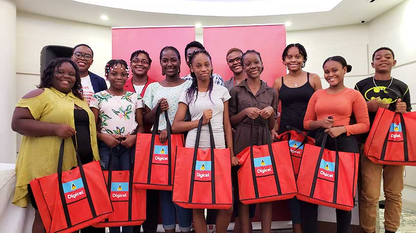 Image of Digicel Executives with Scholarship recipients