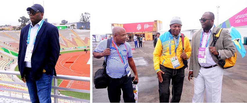 Image: (L-R) Minister of Youth Development and Sports, Edmund Estephane, checked out the similarities between the San Marcos Stadium-Cercado (background) and the stadium under construction in Soufriere; Freelance Journalist, Marius Modeste, Chef de Mission, David Christopher and Minister of Youth Development and Sports Edmund Estaphane at the Games Village. (PHOTO: Dave Pascal)