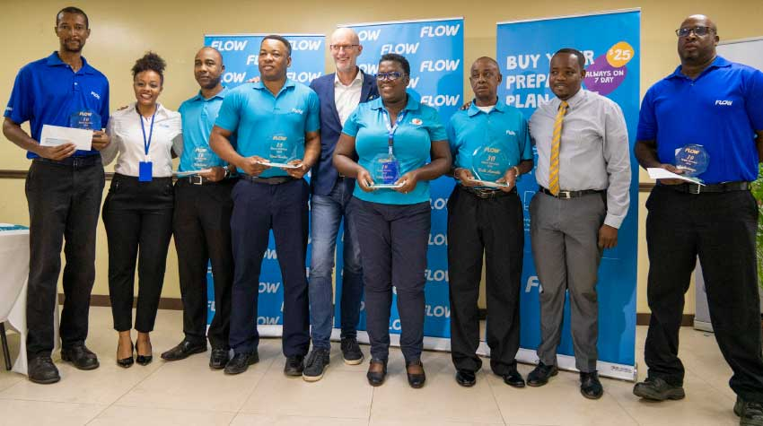 Image: This week FLOW honoured nine team members for their long service to the company.