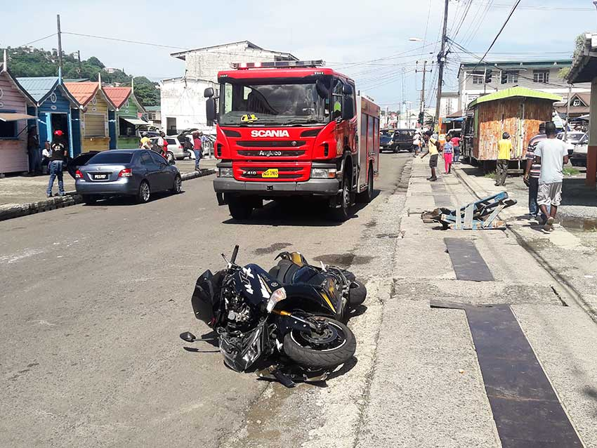 Image of a motorcycle on the road after accident.