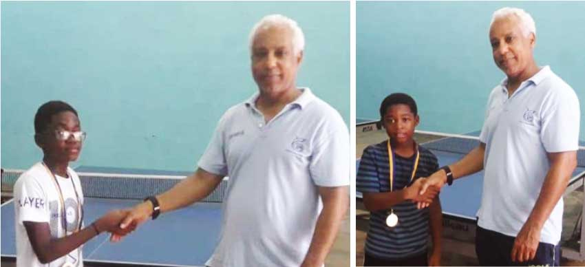 Image: (L-R) Under 13 and 11 National Table Tennis Champions, Nathan Alexander and Leshon Francis receiving their medals from SLTTA President Teddy Mathews. (Photo: SLTTA)