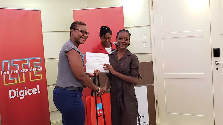 Image of Digicel St. Lucia CEO, Siobhan James-Alexander with one of elated Scholarship recipients