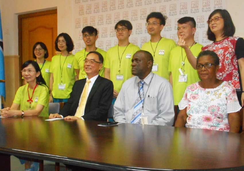 Image: Taiwanese medical volunteers (back row), Dr. Nina Kao, CEO of the Overseas Medical Mission Centre (front row, extreme left) and Ambassador of Taiwan, Douglas C.T. Shen (second from left).