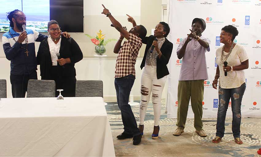 Image of Saint Lucian artistes performing Climate Change Calypso at J-CCCP Presentation at Harbor Club.