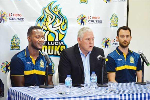 Image: (L-R) Daren Sammy (Saint Lucia Zouks captain), Prime Minister Allen Chastanet, James Foster