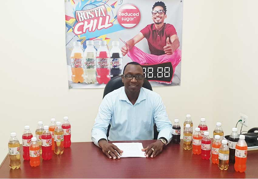 Image of Gaius Harry, Assistant General Manager, SMJ Beverages Saint Lucia, announcing the arrival of the new Busta Chill.