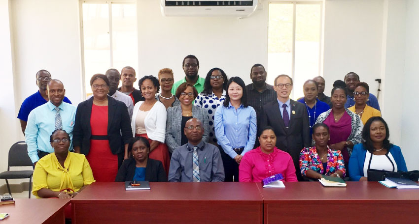 Image: Project Co-ordinator Joanna Huang and Chief of the Taiwan Technical Mission Mario Chen with representatives from the Ministry of Education as well as teachers and principals at a briefing held at the Ministry of Education's Office in Goodlands.