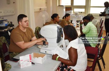 Image of patients in optometry at the USNS Comfort humanitarian mission clinic at OKEU. [Photo: Allen Alexander]